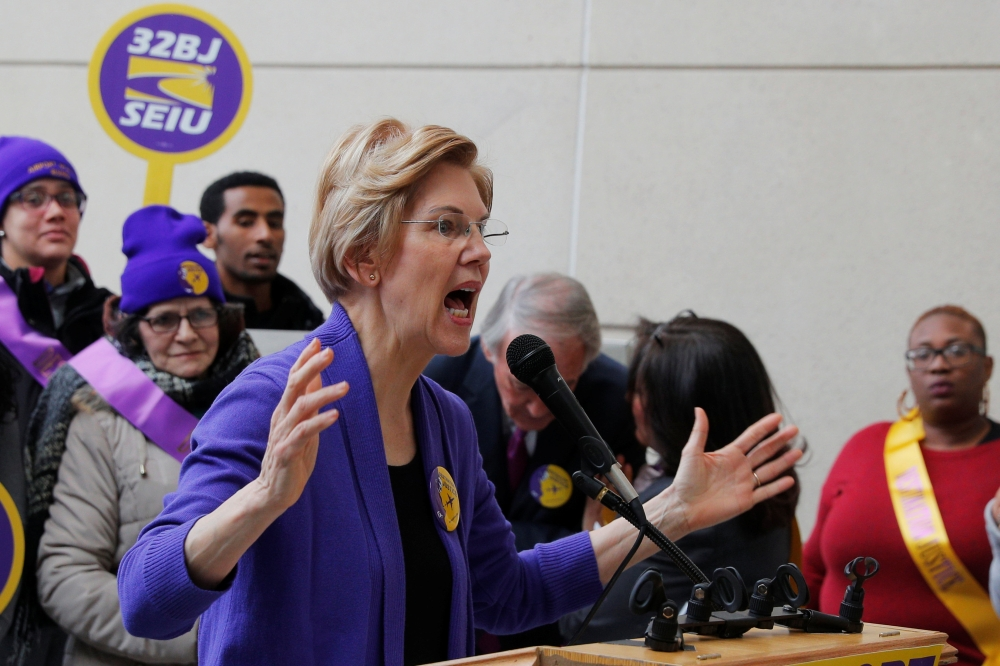 Potential 2020 Democratic presidential candidate and US Senator Elizabeth Warren (D-MA) speaks about federal government employees working without pay and workers trying to unionize at Logan Airport in Boston, Massachusetts, on Monday. — Reuters