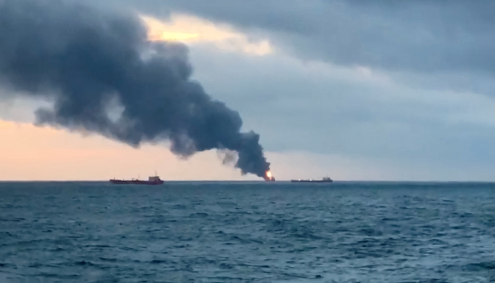 Smoke rises from a fire at a ship in the Kerch Strait near Crimea on Monday in this still image taken from Reuters TV footage. — Reuters
