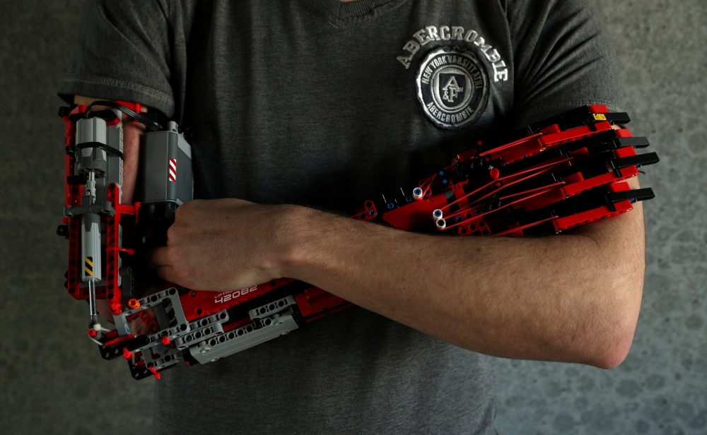 David Aguliar poses with his prosthetic arm built with Lego pieces during an interview with Reuters in Sant Cugat del Valles, near Barcelona, Spain. — Reuters