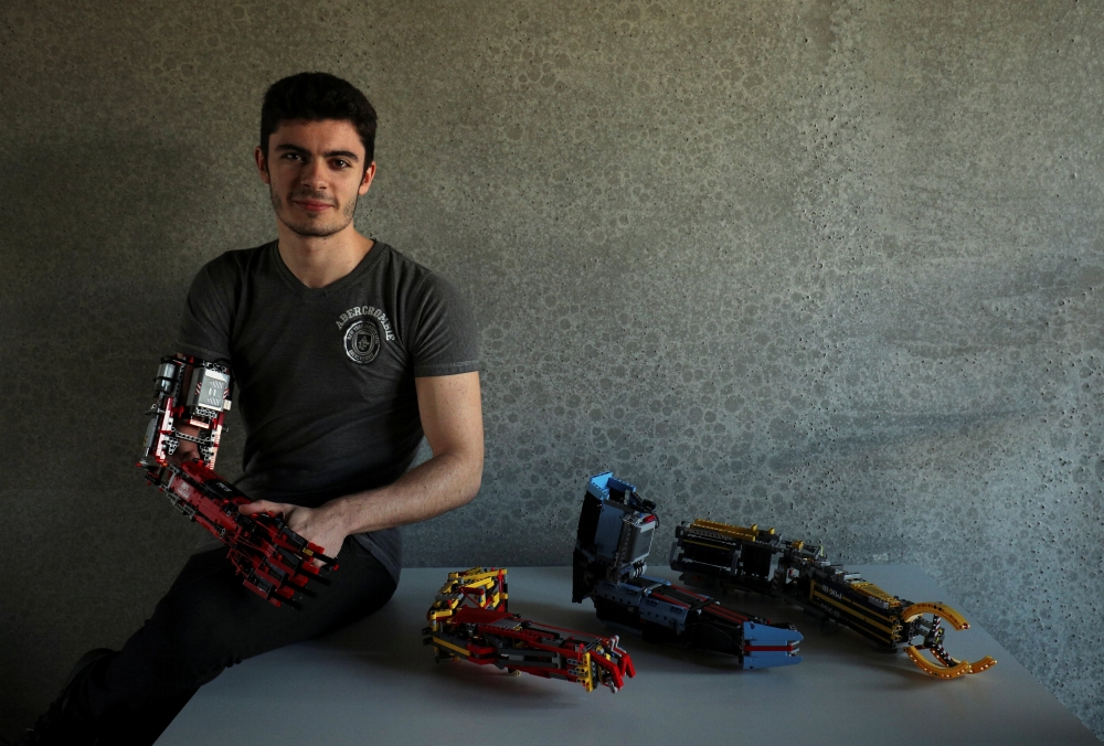 David Aguliar poses with his prosthetic arms built with Lego pieces during an interview with Reuters in Sant Cugat del Valles, near Barcelona, Spain. — Reuters