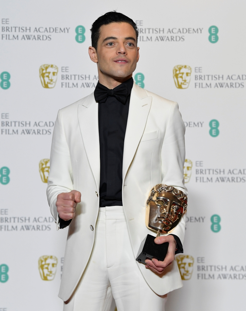 Rami Malek holds the award for leading actor for his performance in 'Bohemian Rhapsody' at the British Academy of Film and Television Awards (BAFTA) at the Royal Albert Hall in London. — Reuters