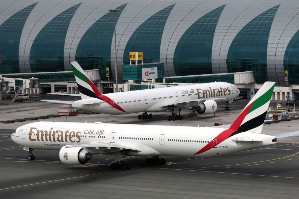 Emirates Airline planes are seen at Dubai International Airport in Dubai, United Arab Emirates, on Friday. — Reuters