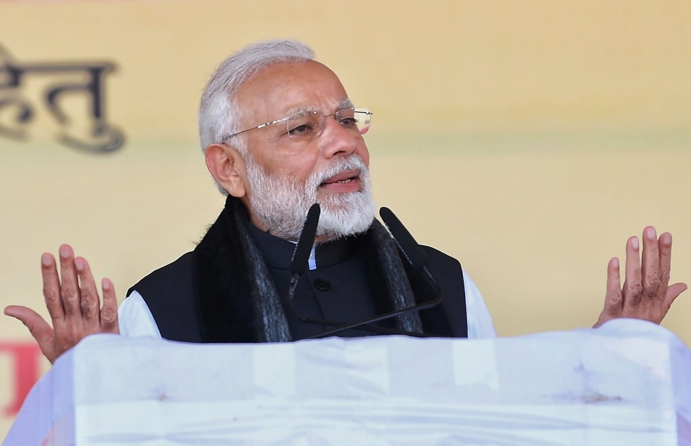 Indian Prime Minister Narendra Modi speaks during the inauguration and foundation stone laying ceremony of various development projects in Jhansi in the Indian state of Uttar Pradesh on Friday. — AFP