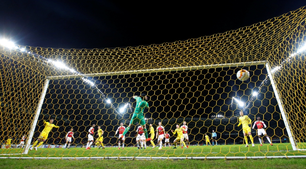 BATE Borisov's Stanislav Dragun scores their first goal  against Arsenal during the Europa League  round of 32 first leg at the Borisov Arena, Barysaw, Belarus, on Thursday. — Reuters
