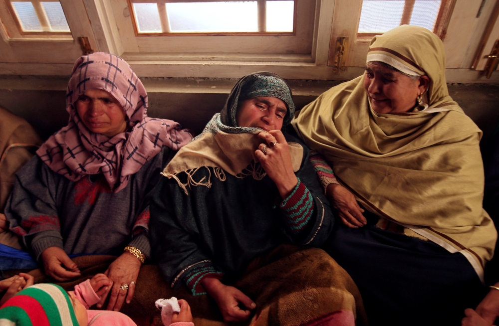 Relatives of Adil Ahmad Dar, who according to police carried out the suicide attack on the Central Reserve Police Force (CRPF) convoy and killed 44 of them on Thursday, mourn inside Adil's residence in Gundbagh village in south Kashmir's Pulwama district, on Friday. — Reuters