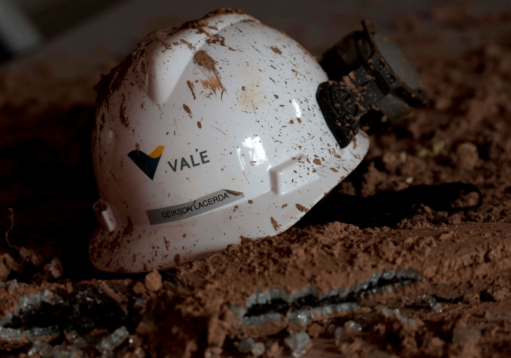 A helmet with a logo of Vale SA is seen in a collapsed dam owned by the company, in Brumadinho, Brazil, in this Feb. 13, 2019 file photo. — Reuters
