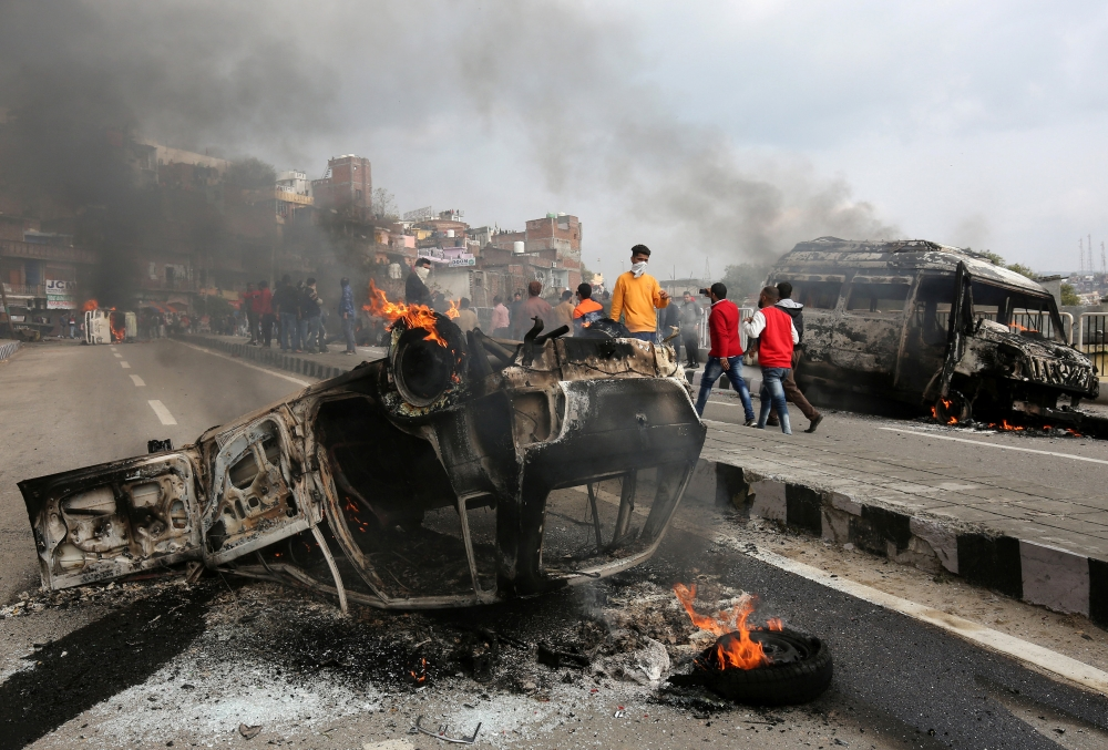 Vehicles set alight by demonstrators are pictured during a protest against the militant attack in Jammu on Friday. — Reuters