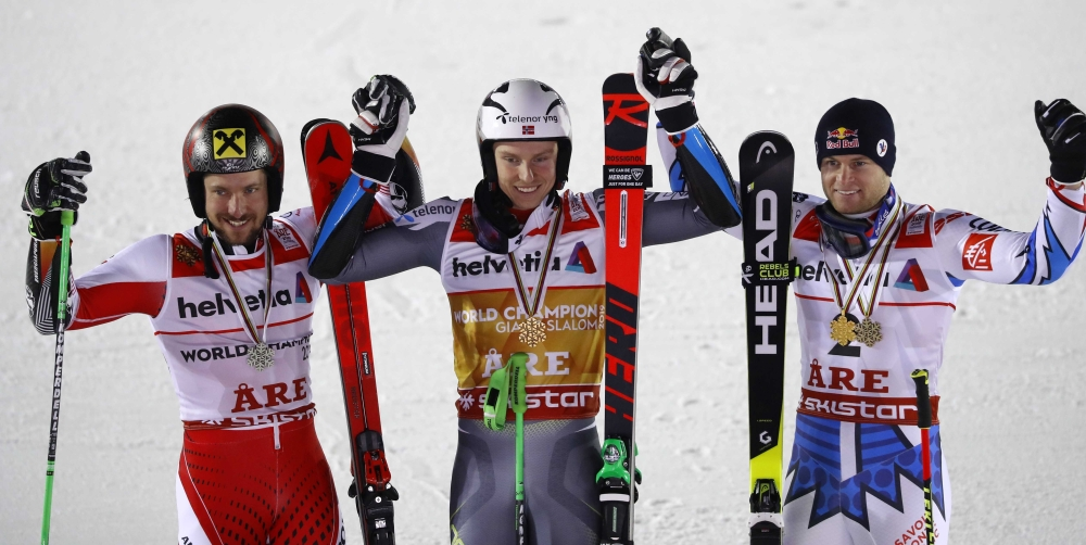 Silver medalist Austria's Marcel Hirscher, gold medalist Norway's Henrik Kristoffersen and bronze medalist France's Alexis Pinturault celebrate after the FIS Alpine World Ski Championships Men's Giant Slalom at the Are, Sweden. — Reuters