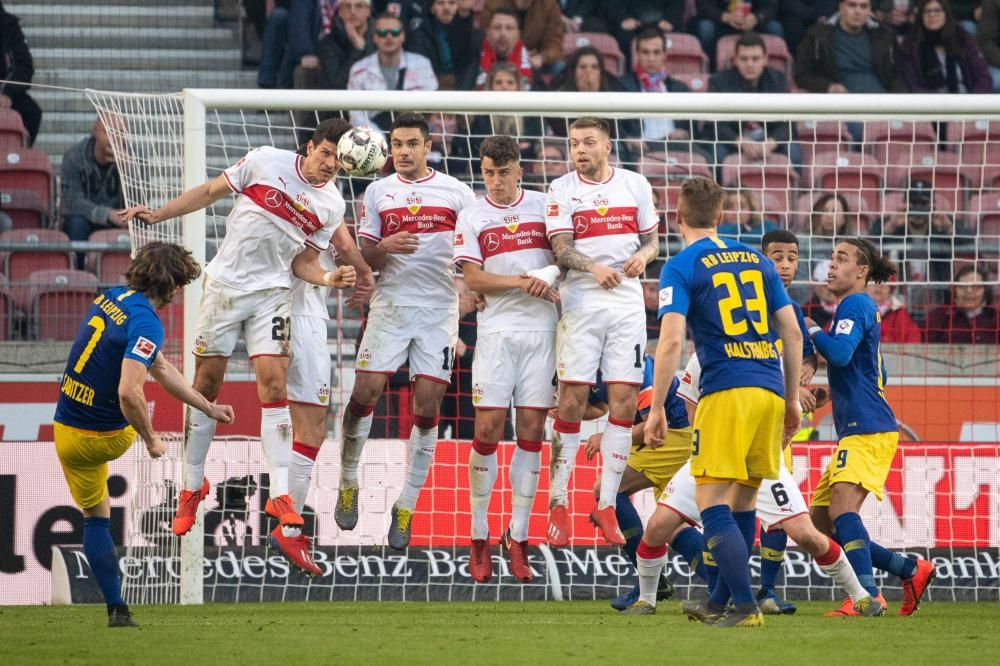 Leipzig's midfielder Marcel Sabitzer (L) scores from a freekick during the German first division Bundesliga football match against VfB Stuttgart in Stuttgart Saturday. — AFP