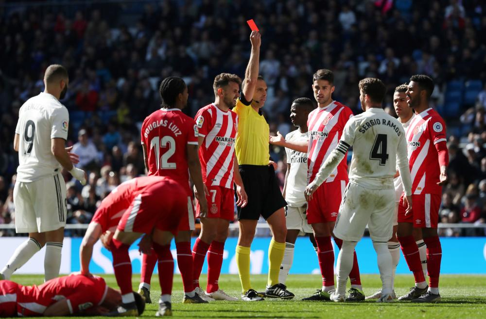 Real Madrid's Sergio Ramos is shown a red card by referee Guillermo Cuadra during the La Liga Santander match against Girona at Santiago Bernabeu in Madrid Sunday. — Reuters