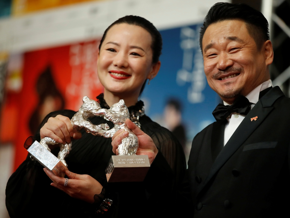 Actors Yong Mei and Wang Jingchun pose with Silver Bears for Best Actor and Actress for Di jiu tian chang (So Long, My Son) after the news conference at the 69th Berlinale International Film Festival in Berlin, Germany. — Reuters