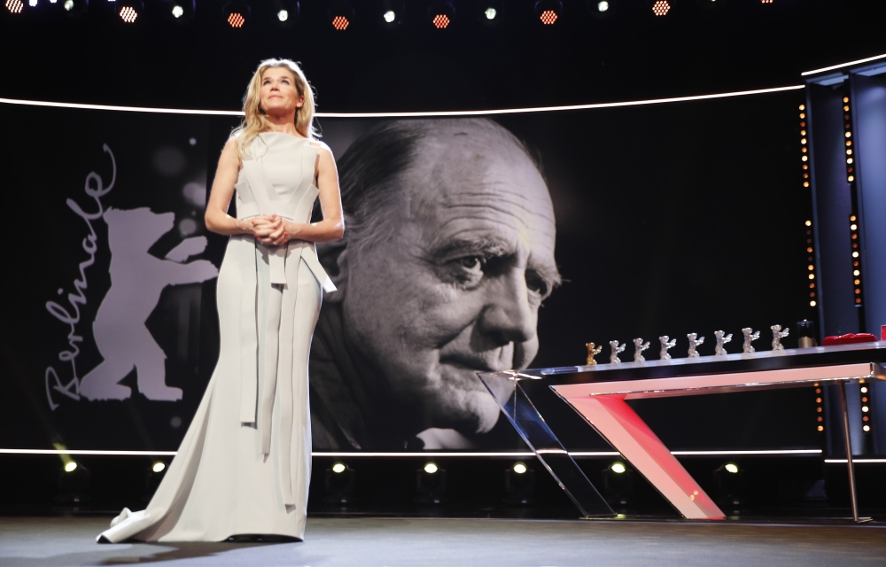 Host Anke Engelke speaks next to the picture of Bruno Ganz during the awards ceremony at the 69th Berlinale International Film Festival in Berlin, Germany. — Reuters