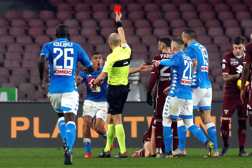 Napoli's Allan is shown a red card by referee Michael Fabbri before a VAR decision overturns it during their match against Torino at Stadio San Paolo, Naples, Sunday. — Reuters