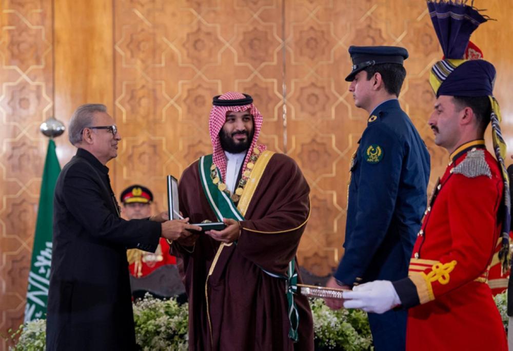 "President Arif Alvi conferring Pakistan's highest civil award — Nishan-e-Pakistan — on Crown Prince Muhammad Bin Salman for his ""outstanding support for reinvigorating Pak-Saudi bilateral relationship."" — SPA"
