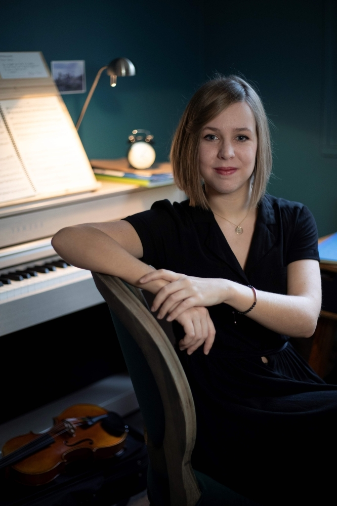 French music composer Camille Pepin poses in her studio in Paris. — AFP
