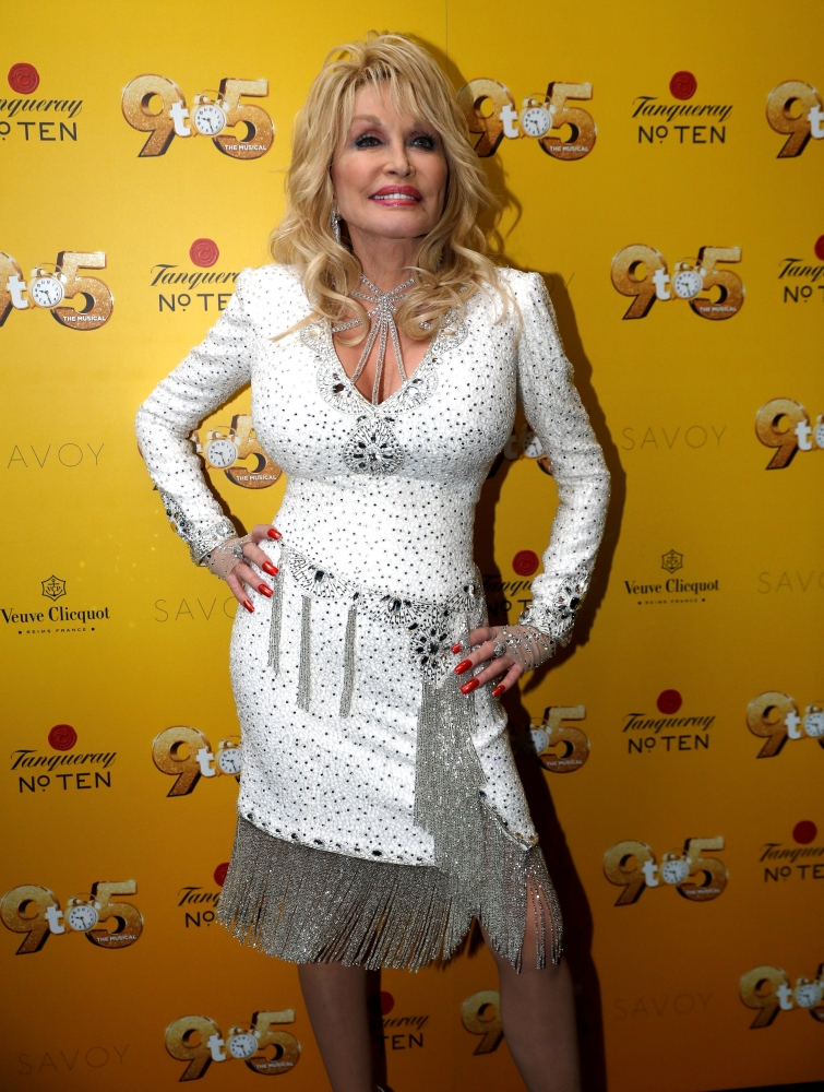 Dolly Parton poses as she arrives for the West End debut of Dolly Parton's '9TO5 The Musical' at the Savoy Theatre, in London. — Reuters