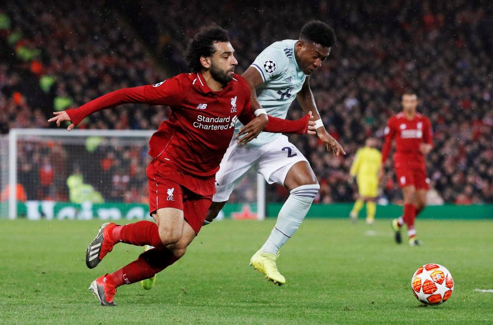 Liverpool's Mohamed Salah (L) in action with Bayern Munich's David Alaba during their Champions League Round of 16 first leg match at Anfield, Liverpool, Tuesday. — Reuters