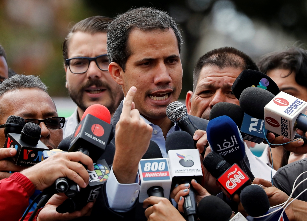 Venezuela's opposition leader Juan Guaido, who many nations have recognized as the country's rightful interim ruler, speaks to the media during a protest of the public transport sector against the government of Venezuela's President Nicolas Maduro in Caracas, Venezuela, on Wednesday. — Reuters