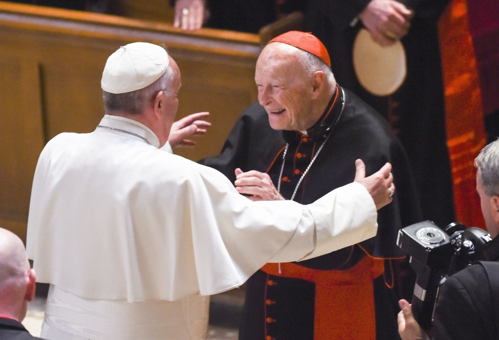 Pope Francis, left, reaches out to hug Cardinal Archbishop emeritus Theodore McCarrick after the Midday Prayer of the Divine with more than 300 US Bishops at the Cathedral of St. Matthew the Apostle in Washington in this Sept. 23, 2015 file photo. — AFP