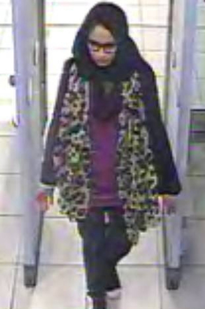 A video grab taken from CCTV, received from the Metropolitan Police Service (MPS) on Feb. 23, 2015, shows Shamima Begum passing through security barriers at Gatwick Airport, south of London. Shamima Begum, now 19, expressed no regrets about fleeing her London life four years ago but said that two of her children had died and, pregnant with her third, she wanted to return. — AFP