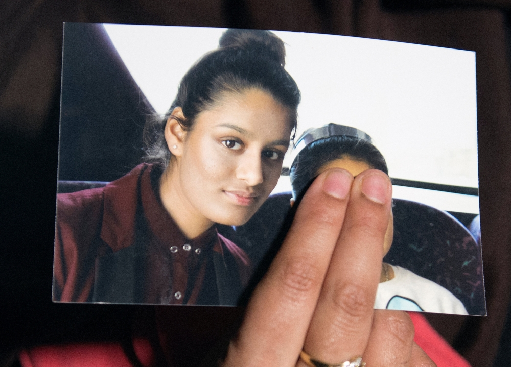 Renu Begum, sister of teenage British girl Shamima Begum, holds a photo of her sister as she makes an appeal for her to return home at Scotland Yard, in London, back in 2015.— Reuters