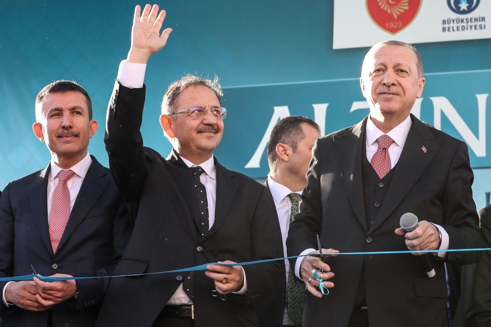 Turkish President and the leader of Turkey's ruling Justice and Development Party (AKP) Recep Tayyip Erdogan, right,) and AKP Party candidate for Ankara mayorship Mehmet Ozhaseki, second left, attend the AKP campaign rally at Altindag district in Ankara, Turkey, on Wednesday. — AFP