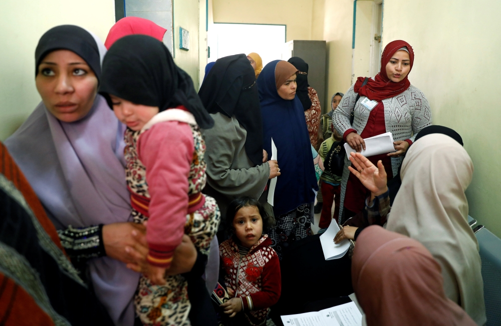 A family planning adviser speaks with Egyptian mothers at a new clinic in the province of Fayoum, southwest of Cairo, Egypt, on Thursday. — Reuters