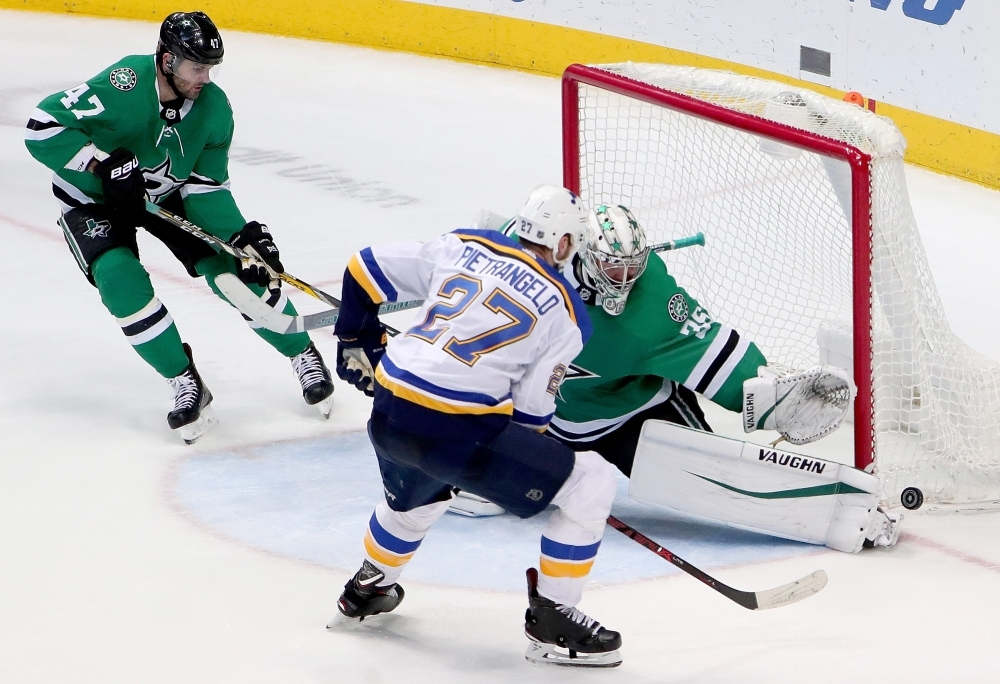 Anton Khudobin No. 35 of the Dallas Stars blocks a shot on goal against Alex Pietrangelo No. 27 of the St. Louis Blues in the third period at American Airlines Center on Thursday in Dallas, Texas. — AFP