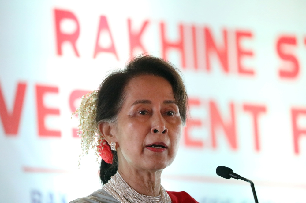Myanmar's State Counselor Aung San Suu Kyi delivers a speech at Rakhine State Investment Fair at Ngapali beach in Thandwe, Rakhine, Myanmar, on Friday. — Reuters