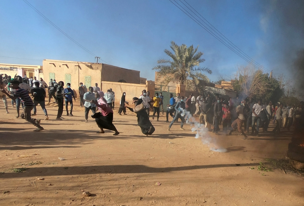Sudanese demonstrators run from a teargas canister fired by riot policemen to disperse them as they participate in anti-government protests in Omdurman, Khartoum, Sudan, in this Jan. 20, 2019 file photo. — Reuters