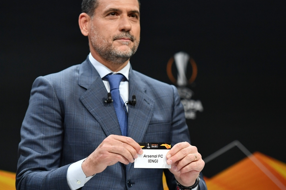 Former Spanish football player Andres Palop displays the name of Arsenal football club during the draw for the Europa League round of sixteen, on Friday in Bern. — AFP