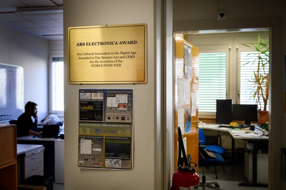 A plaque is displayed next to the former office of the inventor of the World Wide Web Tim Berners-Lee (on the right) at the European Organisation for Nuclear Research (CERN) in Meyrin, near Geneva. — AFP