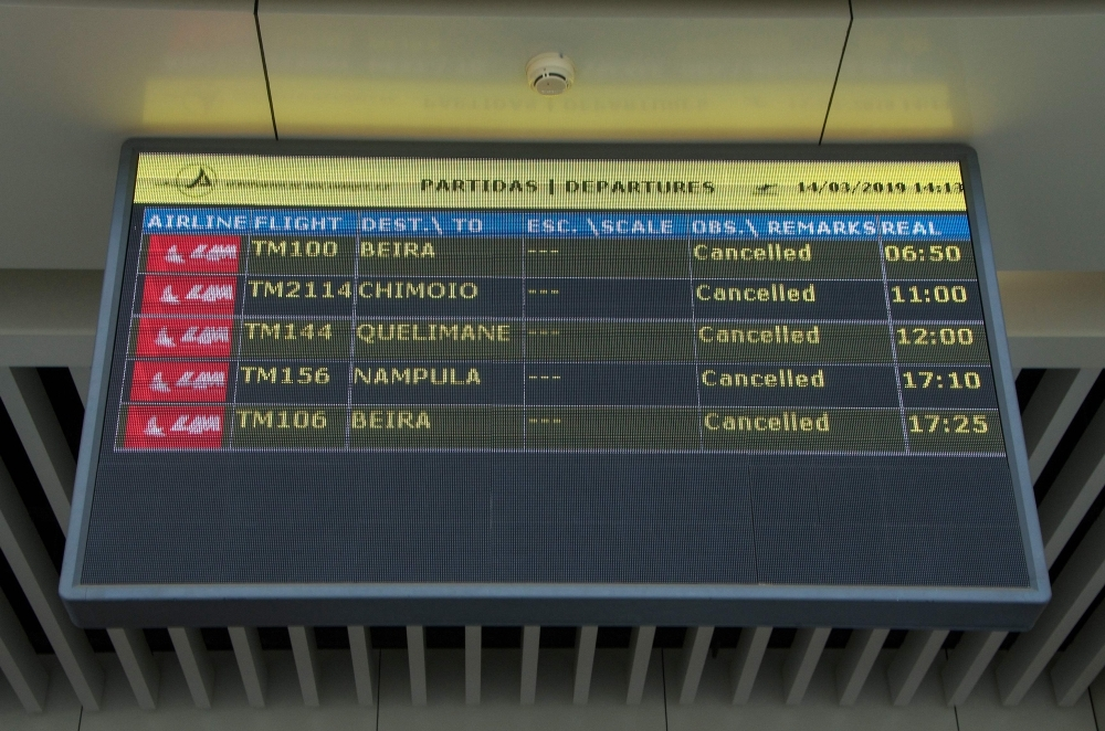A Departures electronic panel indicating that all flights are canceled is seen at the Maputo International Airport in Mozambique on Thursday. — AFP