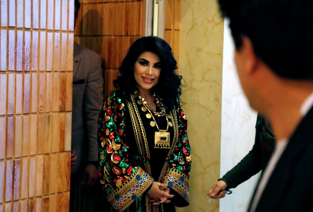 Defying threats, famous Afghan singer Aryana is back home