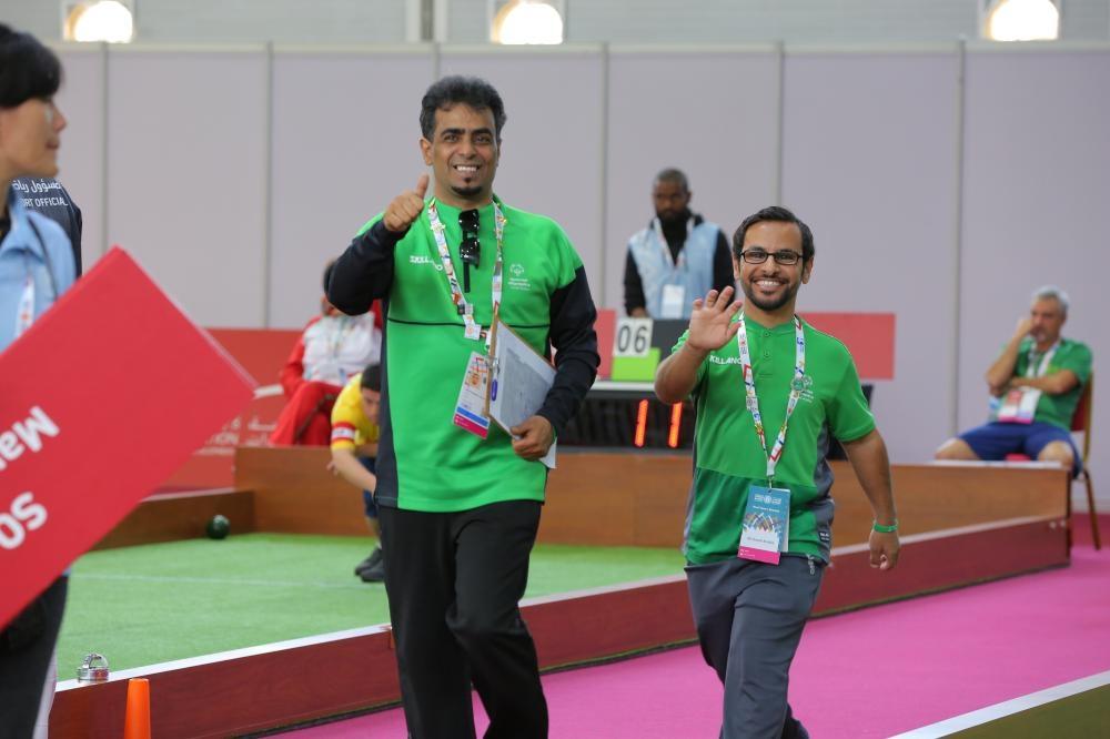 Rayed Al-Oufi with head coach Abdulrahman Al-Hujaili