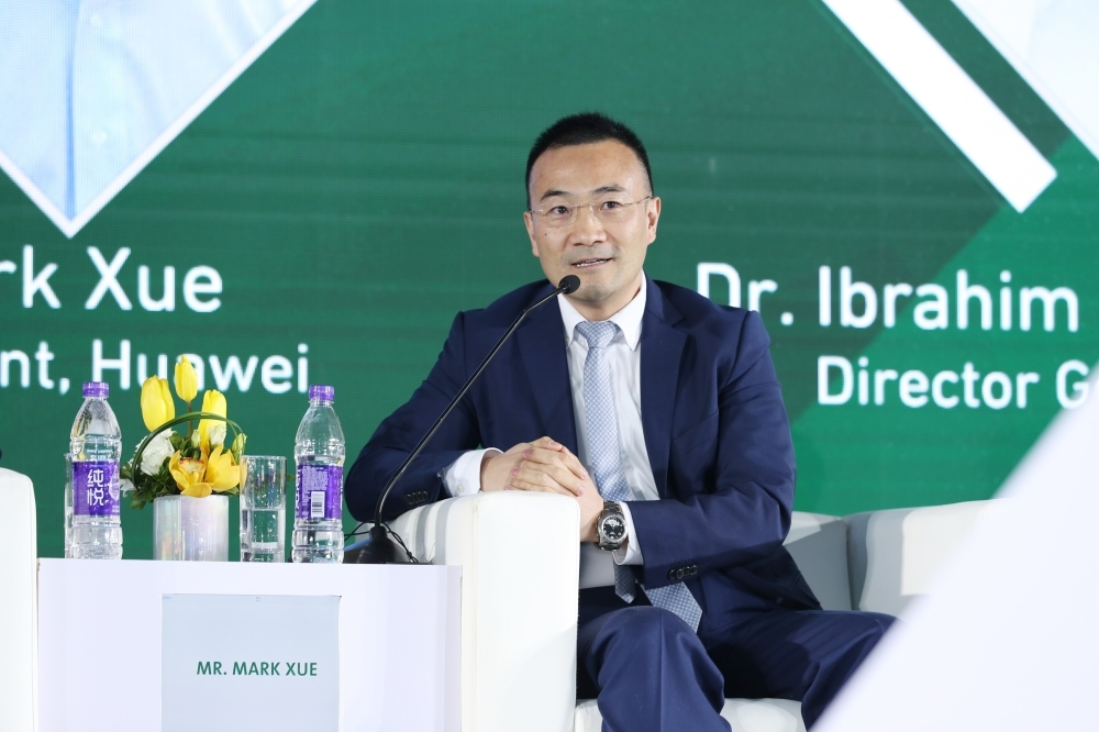 Mark Xue speaks in panel discussion. — Courtesy photo