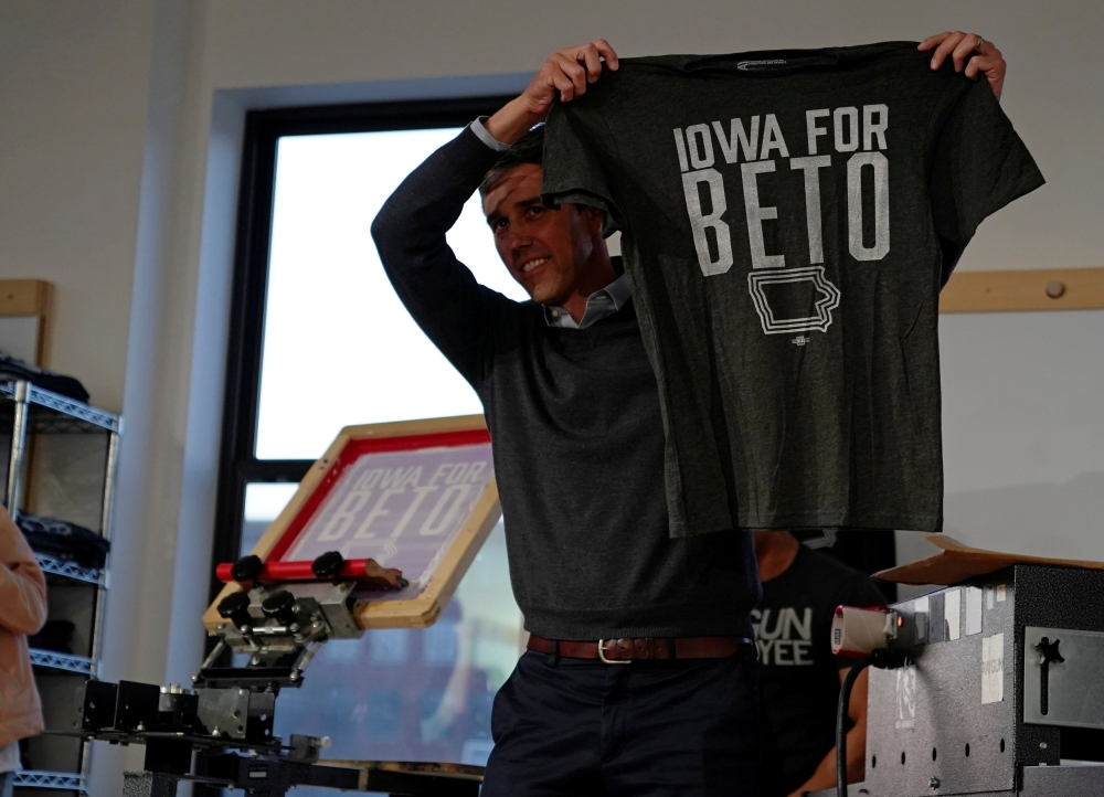 """Democratic 2020 presidential candidate Beto O'Rourke, 46, holds up a """"Iowa For Beto"""" screen-printed shirt at Raygun clothing store during a three day road trip across Iowa, in Cedar Rapids, Iowa, in this March 15, 2019 file photo. — Reuters"""
