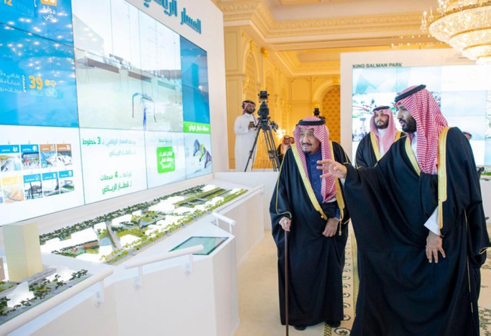 Custodian of the Two Holy Mosques King Salman being briefed by Crown Prince Muhammad Bin Salman, deputy premier and minister of defense, on the salient features of the four mega projects during an inauguration ceremony in Riyadh on Tuesday. — SPA