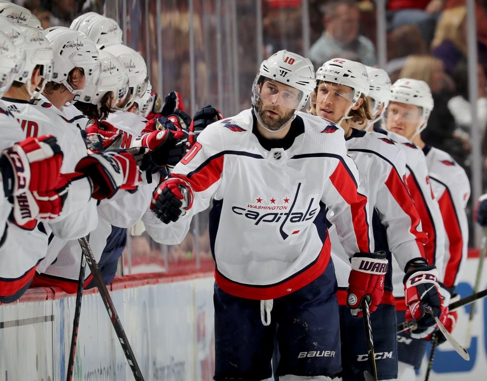 Brett Connolly (front) of the Washington Capitals celebrates his goal with teammates on the bench during their NHL game against the New Jersey Devils at Prudential Center in Newark, New Jersey, Tuesday. — AFP
