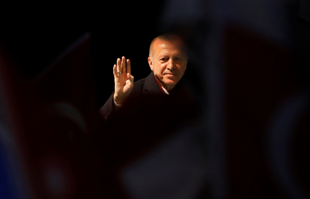 Turkish President Recep Tayyip Erdogan greets AK Party supporters during a rally for the upcoming local elections in Istanbul, this week.