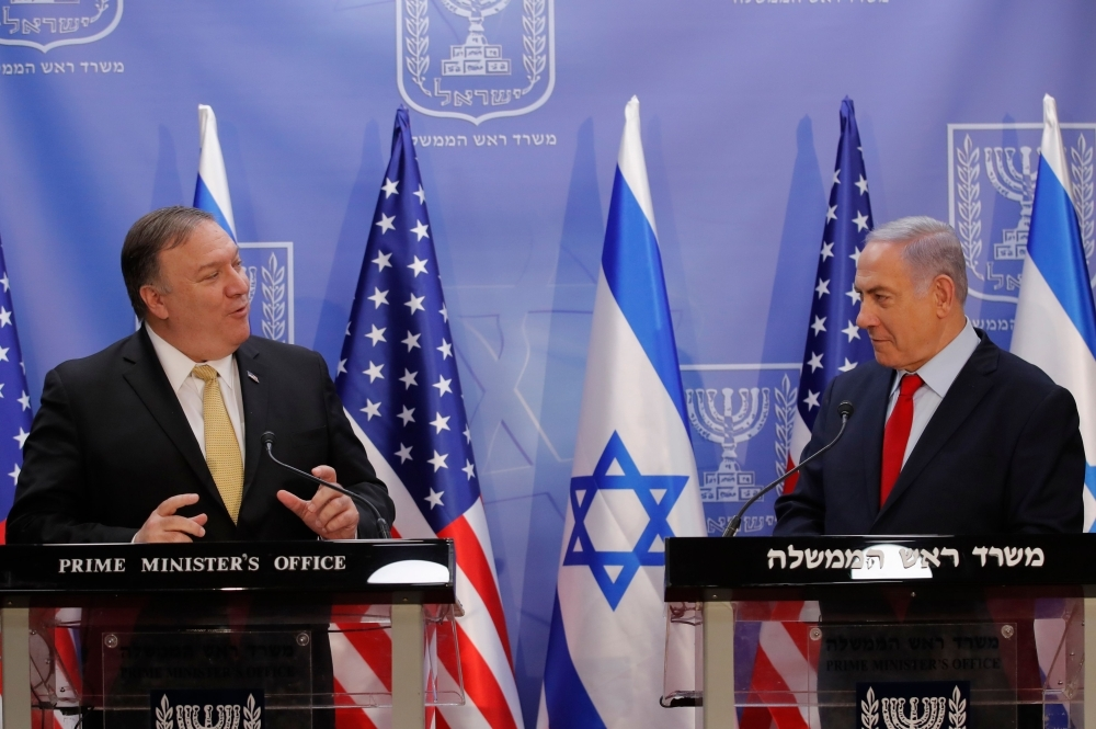 US Secretary of State Mike Pompeo, left, and Israeli Prime Minister Benjamin Netanyahu deliver a joint statement during their meeting in Jerusalem on Wednesday. — AFP