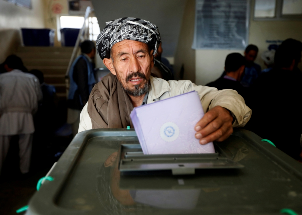 An Afghan man casts his vote during the parliamentary election at a polling station in Kabul, Afghanistan, in this Oct. 21, 2018 file photo. — Reuters
