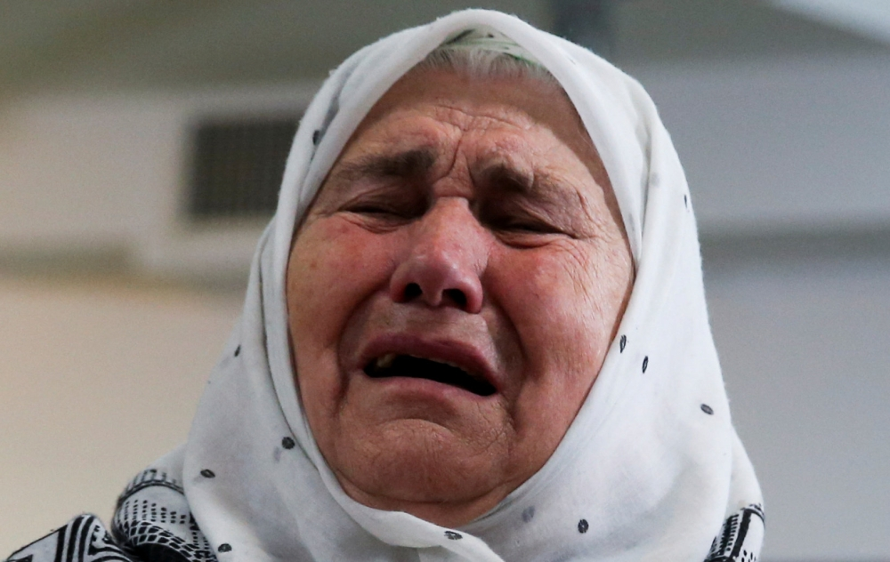 A woman reacts after the verdict on former Bosnian Serb political leader Radovan Karadzic's appeal of his 40 year sentence for war crimes, in the Memorial center Potocari near Srebrenica, Bosnia and Herzegovina, on Wednesday. — Reuters