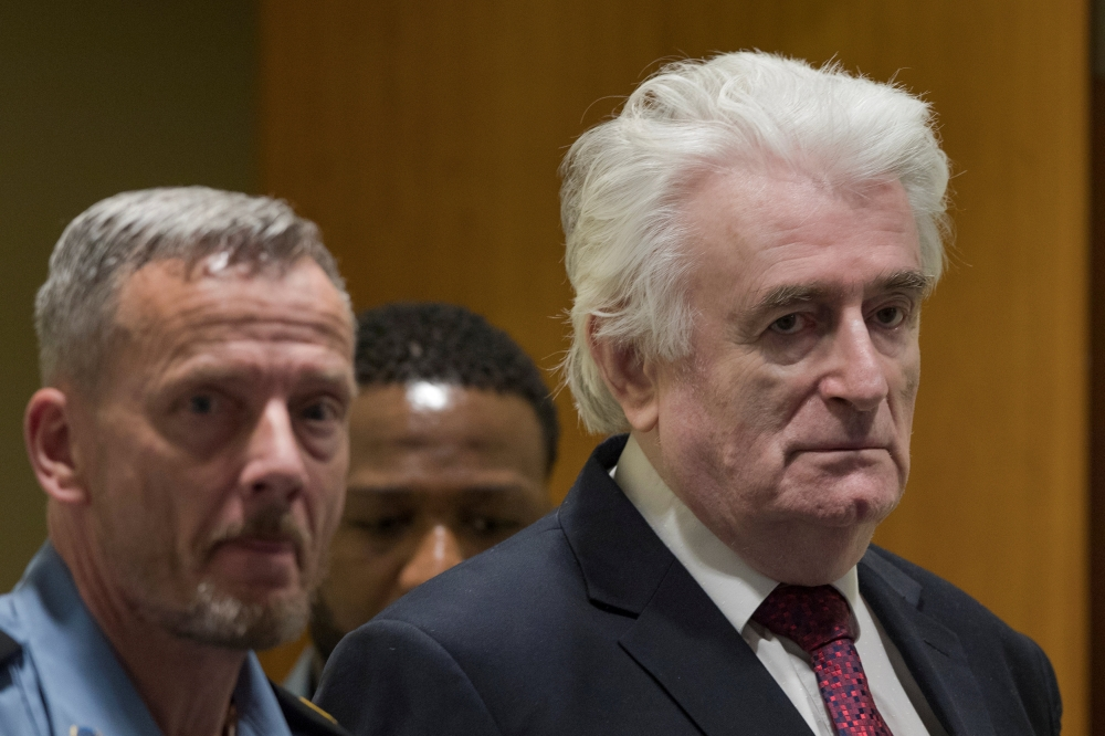 "Former Bosnian Serb leader Radovan Karadzic appears before the Appeals Chamber of the International Residual Mechanism for Criminal Tribunals (""Mechanism"") ruling on a appeal of his 40 year sentence for war crimes in The Hague, Netherlands, on Wednesday. — Reuters"