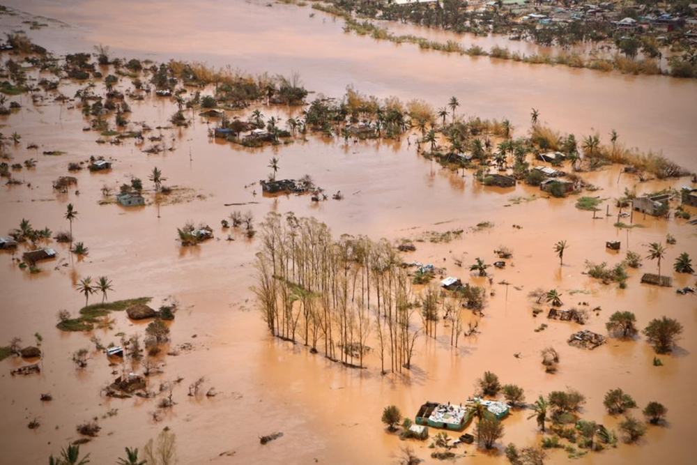 An aerial view shows the flooded plane surrounding Beira, central Mozambique, on Wednesday after the passage of the cyclone Idai. — AFP