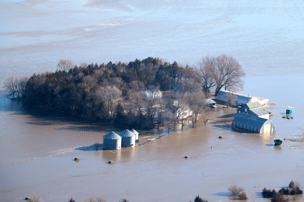 This image released by the Office of Nebraska Governor Pete Ricketts shows a flooded farm in Nebraska on March 15, 2019. — AFP