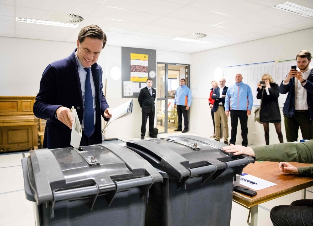 Dutch Prime Minister Mark Rutte casts his ballot for Netherlands' provincial and water authorities elections at a polling station in Wolters primary school in The Hague on Wednesday. — AFP