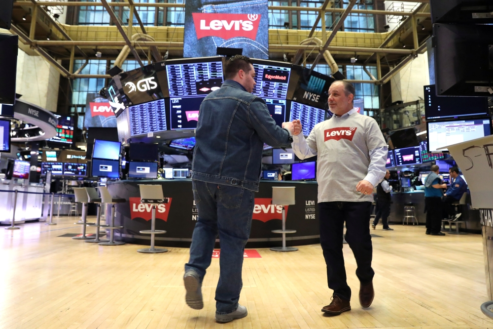 Traders wear Levis clothing ahead of the Levi Strauss & Co. IPO on the floor of the New York Stock Exchange (NYSE) in New York, US, Thursday. — Reuters
