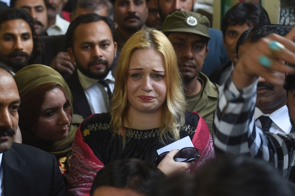 Czech model Tereza Hluskova weeps after the court decision to sentence her to eight years and eight months in prison for attempted heroin smuggling in Lahore, Pakistan, on Wednesday. — AFP