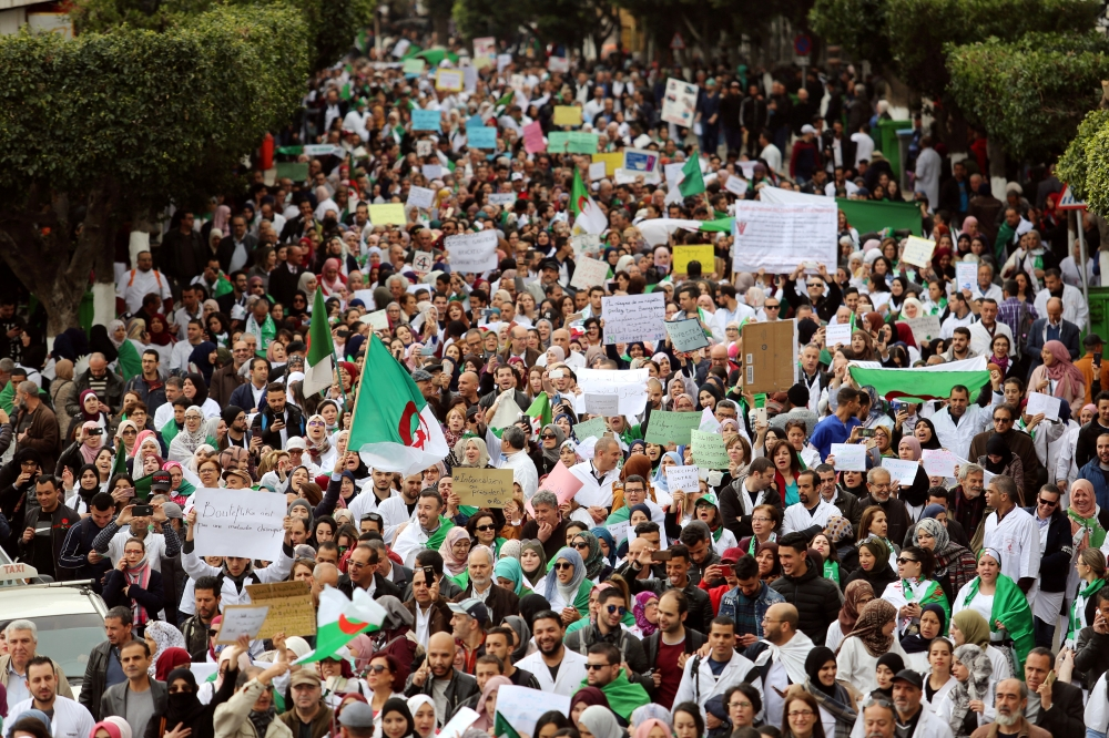 Health workers carry national flags and banners as they march during a protest calling on President Abdelaziz Bouteflika to quit, in Algiers, Algeria, in this March 19, 2019 file photo. — Reuters